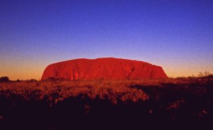 photo of Uluru against a turquoise blue sky